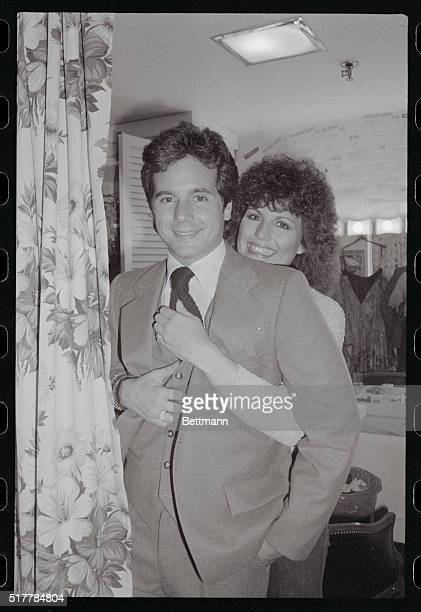 Lucie Arnaz hugs her younger brother Desi Arnaz Jr backstage following her performance in the musical They're Playing Our Song It is the first time...
