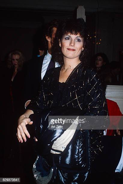 Lucie Arnaz wearing a black beaded dress to a formal event circa 1970 New York