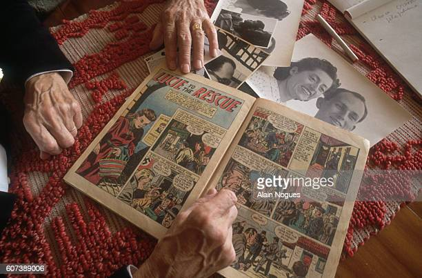 Lucie Aubrac and her husband French Resistance leader Raymond Aubrac look at an old comic strip entitled Lucie to the Rescue They are home two days...