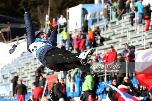 Lucie Charvatova of Czech Republic is throwed in the air by her team mates in celebration of winning the 3rd place after the Women 7.5 km Sprint...