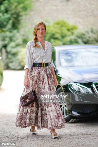 Lucie de la Falaise wears a shirt, a Dior belt, a pleated floral print skirt , outside Dior, during Paris Fashion Week Haute Couture Fall Winter...