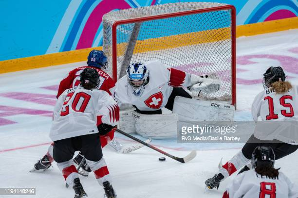 Lucie Gruntova of Czech Republic tries to score against Goalkeeper Margaux Favre of Switzerland during Women's 6-Team Tournament Preliminary Round -...