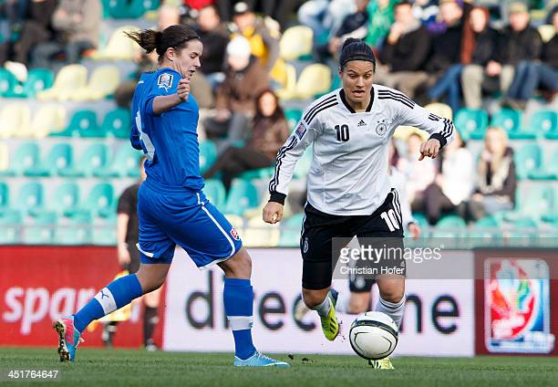 Lucie Harsanyova of Slovakia competes for the ball with Dzsenifer Maroszan of Germany during the FIFA Women's World Cup 2015 Qualifier between...
