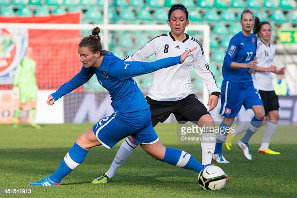 Lucie Harsanyova of Slovakia competes for the ball with Nadine Kessler of Germany during the FIFA Women's World Cup 2015 Qualifier between Slovakia...