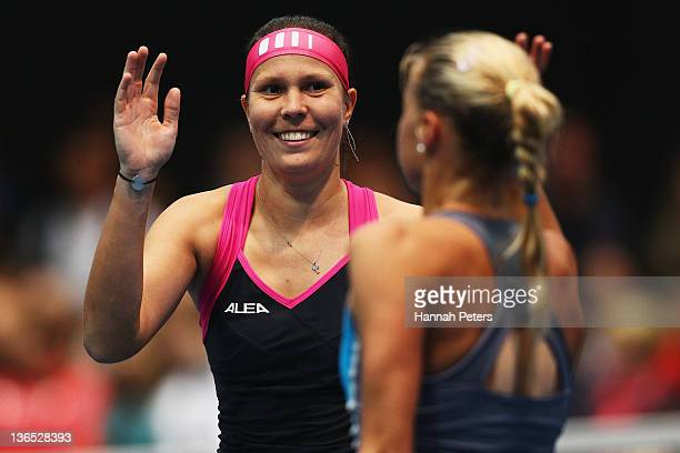 Lucie Hradecka and Andrea Hlavackova of the Czech Republic celebrate beating Flavia Pennetta of Italy and Julia Goerges of Germany in the Women's...