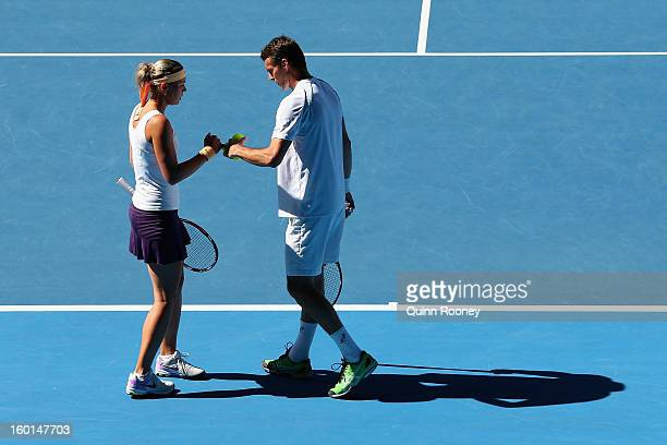 Lucie Hradecka and Frantisek Cermak of the Czech Republic talk tactics in their mixed doubles final match against Matthew Ebden and Jarmila Gajdosova...