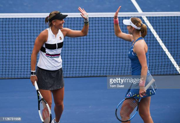 Lucie Hradecka of Czech Republic and Ekaterina Makarova of Russia celebrate a point during their double's semi final match against Lara Arruabarrena...
