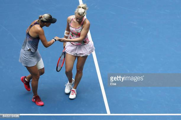 Lucie Hradecka of Czech Republic and Katerina Siniakova of Czech Republic react against YungJan Chan of Taiwan and Martina Hingis of Switzerland...