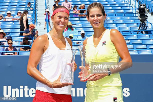 Lucie Hradecka of Czech Republic, left, and Julia Goerges of Germany celebrate their win over Chia-Jung Chuang of Taipei and Chen Liang of China in...