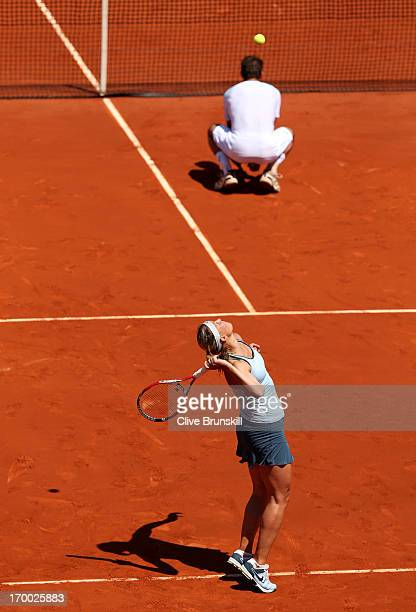 Lucie Hradecka of Czech Republic serves behind her team-mate Frantisek Cermak in their mixed doubles final against Kristina Mladenovic of France and...