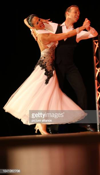 Lucie Jeanne and Cyril Passerat of France dance on the stage of the culture and congress center in Gera, Germany, 07 September 2013. During the...