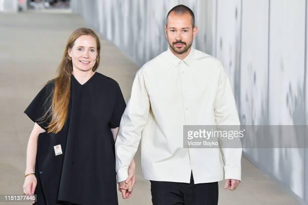 Lucie Meier and Luke Meier walk the runway during the finale of the Jil Sander Menswear Spring Summer 2020 show as part of Paris Fashion Week on June...