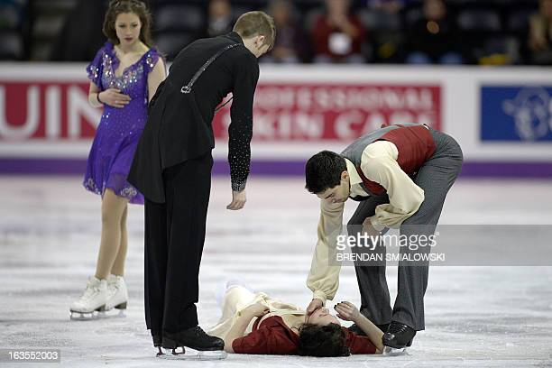 Lucie Mysliveckova watches as Italian skater Luca Lanotte checks on his partner Anna Cappellini after colliding with with Neil Brown of the Czech...