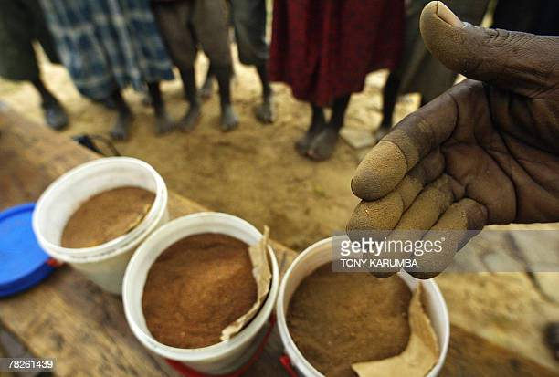 Lucie PEYTERMANN Ugandan traditional healer, Isaac Kanyike stirs his traditionally prepared concotions in the village of Buvunya, 65 kms east of the...