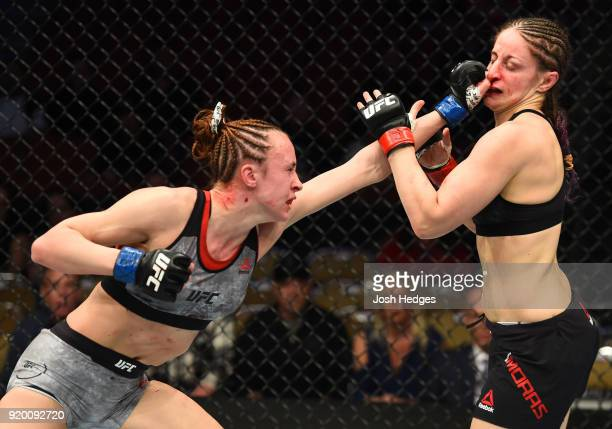 Lucie Pudilova of Czech Republic punches Sarah Moras of Canada in their women's bantamweight bout during the UFC Fight Night event at Frank Erwin...