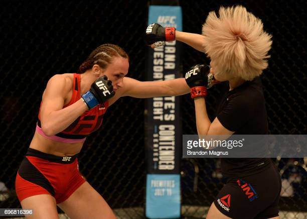 Lucie Pudilova of the Czech Republic punches Ji Yeon Kim of South Korea in their women's bantamweight bout during the UFC Fight Night event at the...