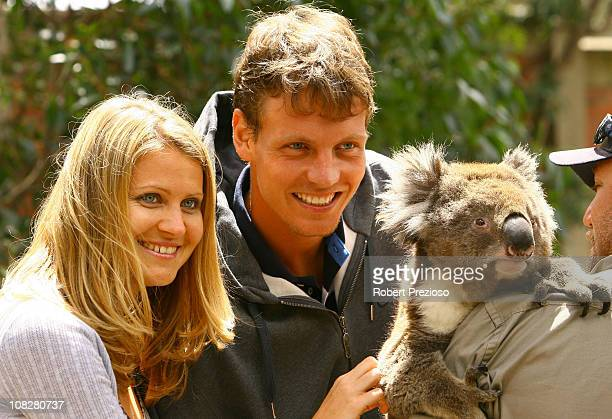 Lucie Safarova and Tomas Berdych of the Czech Republic pose with a koala during a visit to Melbourne Zoo on day eight of the 2011 Australian Open at...