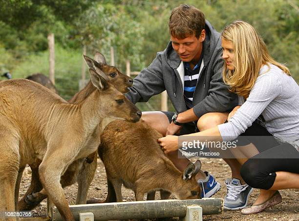 Lucie Safarova and Tomas Berdych of the Czech Republic pose with kangaroos during a visit to Melbourne Zoo on day eight of the 2011 Australian Open...