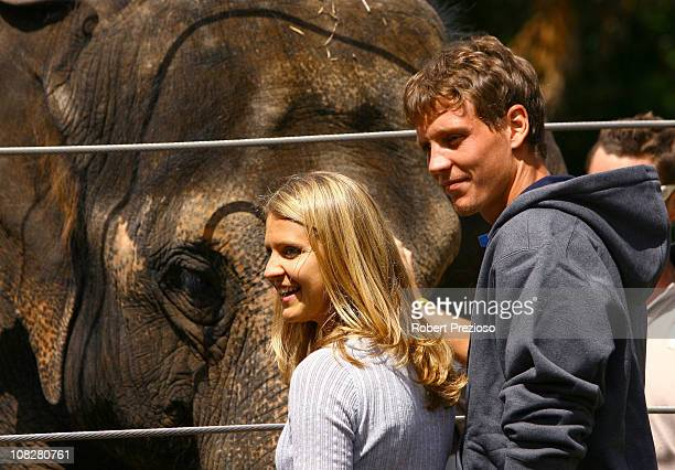 Lucie Safarova and Tomas Berdych of the Czech Republic pose with a elephant during a visit to Melbourne Zoo on day eight of the 2011 Australian Open...