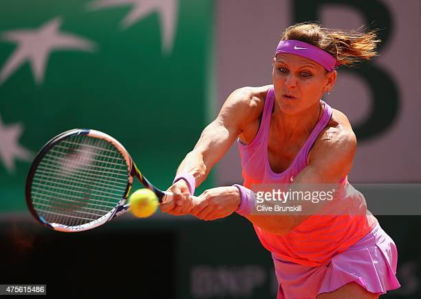 Lucie Safarova of Czech Repbulic plays a backhand in her Women's quarter final match against Garbine Muguruza of Spain on day of the 2015 French Open...