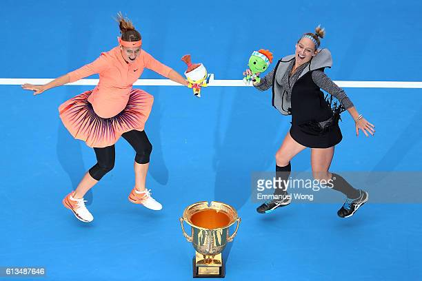 Lucie Safarova of Czech Republic and Bethanie MattekSands of the United States pose with their trophy after winning the Womens's doubles final match...