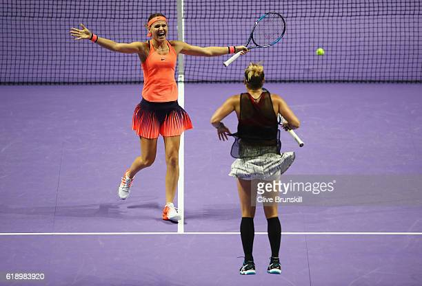Lucie Safarova of Czech Republic and Bethanie MattekSands of the United States celebrate victory in their semifinal doubles match against Caroline...