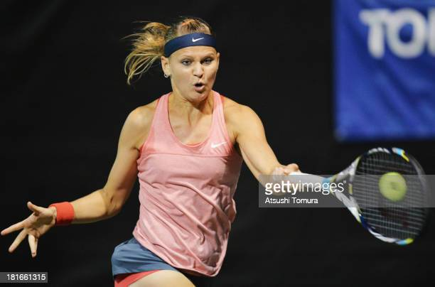 Lucie Safarova of Czech Republic in action during her women's singles second round match against Roberta Vinci of Italy during day two of the Toray...