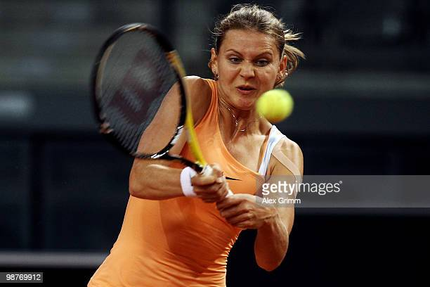 Lucie Safarova of Czech Republic plays a backhand during her quarter final match against Anna Lapushchenkova of Russia at day five of the WTA Porsche...
