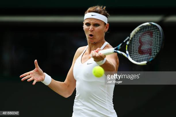 Lucie Safarova of Czech Republic plays a forehand return during her Ladies' Singles quarterfinal match against Ekaterina Makarova of Russia on day...