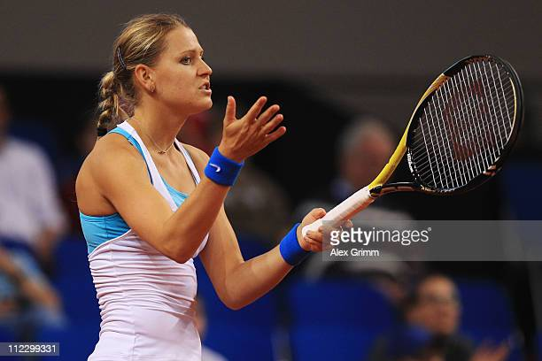 Lucie Safarova of Czech Republic reacts during her first round match against Kristina Barrois of Germany during the Porsche Tennis Grand Prix at...