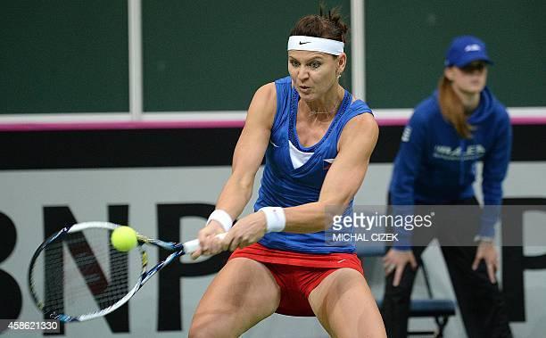 Lucie Safarova of Czech Republic returns a ball to Angelique Kerber of Germany during the International Tennis Federation Fed Cup final match Czech...