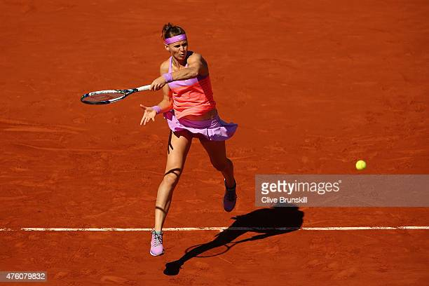 Lucie Safarova of Czech Republic returns a shot in the Women's Singles Final againt Serena Williams of the United States on day fourteen of the 2015...