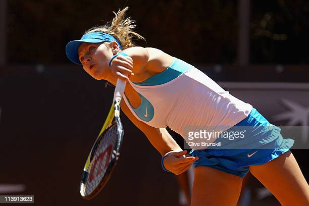 Lucie Safarova of Czech Republic serves during first round match against Kimiko DateKrumm of Japan during day three of the Internazoinali BNL...