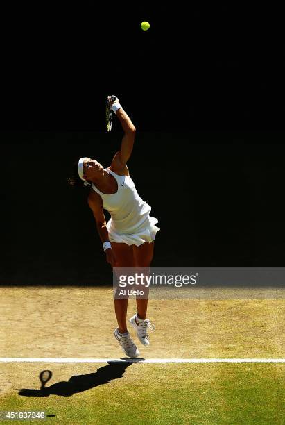 Lucie Safarova of Czech Republic serves during her Ladies' Singles semifinal match against Petra Kvitova of Czech Republic on day ten of the...