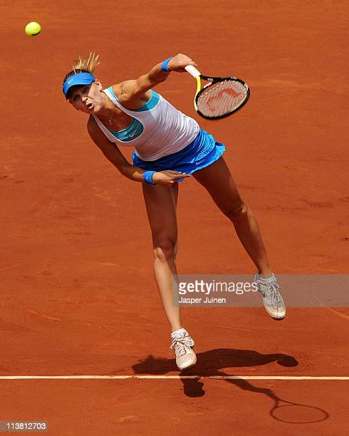 Lucie Safarova of Czech Republic serves the ball to Victoria Azarenka of Belarus during day seven of the Mutua Madrilena Madrid Open Tennis on May 6,...