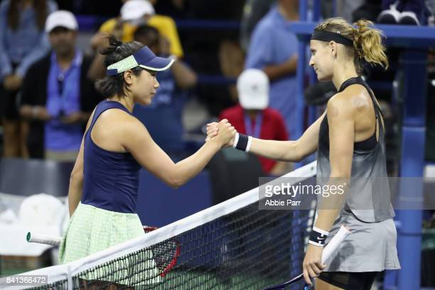Lucie Safarova of Czech Republic shakes hands after defeating Nao Hibino of Japan in their second round Women's Singles match on Day Four of the 2017...