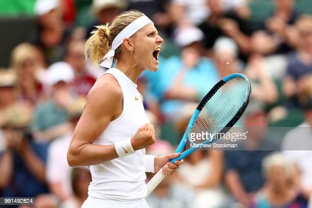 Lucie Safarova of Poland celebrates match point against Agnieszka Radwanska of Poland during their Ladies' Singles second round match on day three of...
