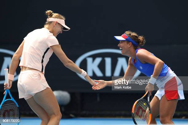 Lucie Safarova of the Czech Republic and Barbora Strycova of the Czech Republic talk tactics in their third round women's doubles match against...