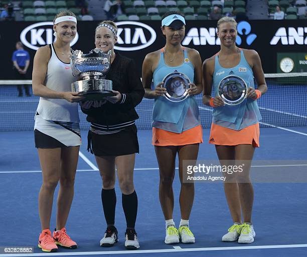 Lucie Safarova of the Czech Republic and Bethanie MattekSands of the United States pose with their trophy after their Women's Doubles Final match...