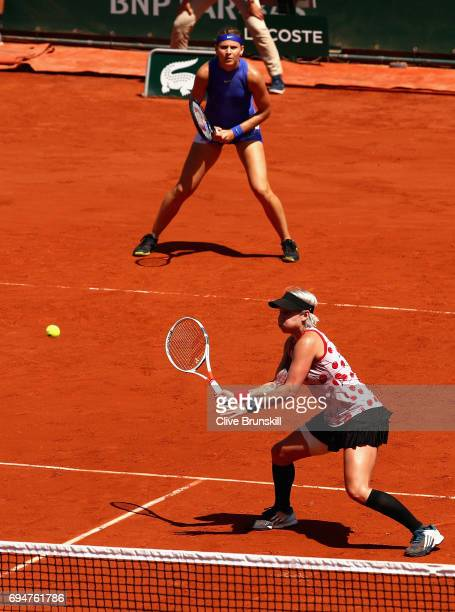 Lucie Safarova of The Czech Republic and partner Bethanie MattekSands of The United States return the ball during the ladies doubles final match...