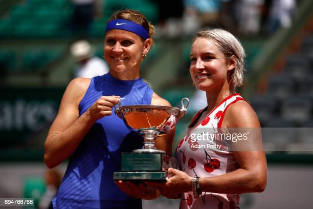 Lucie Safarova of The Czech Republic and partner Bethanie MattekSands of The United States celebrate victory with the trophy following the ladies...