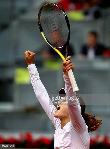 Lucie Safarova of the Czech Republic celebrates match point against Nadia Petrova of Russia in their quarter final match during the Mutua Madrilena...