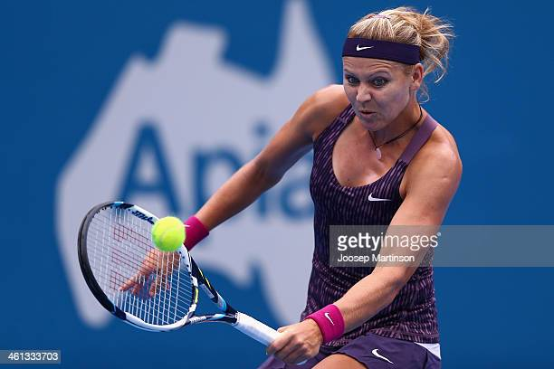 Lucie Safarova of the Czech Republic plays a backhand in her quarter final match against Petra Kvitova of the Czech Republic during day four of the...