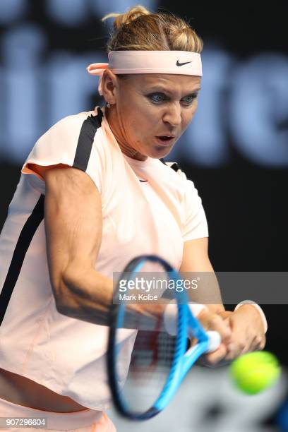 Lucie Safarova of the Czech Republic plays a backhand in her third round match against Karolina Pliskova of the Czech Republic on day six of the 2018...