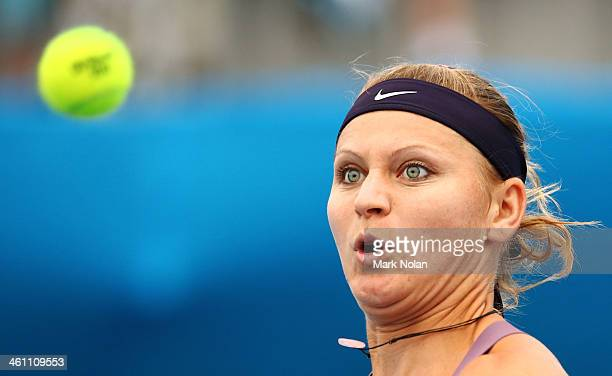 Lucie Safarova of the Czech Republic plays a forehand in her match against Caroline Wozniacki of Denmark during day three of the 2014 Sydney...