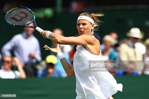 Lucie Safarova of The Czech Republic plays a forehand shot during the Ladies Singles first round match against Bethanie MattekSands of The united...