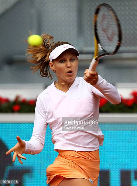 Lucie Safarova of the Czech Republic plays a forehand to Nadia Petrova of Russia in their quarter final match during the Mutua Madrilena Madrid Open...