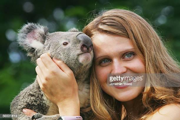 Lucie Safarova of the Czech Republic poses for photographs with an Australian native Koala named Doodah during the WTA Mondial Australian Women's...
