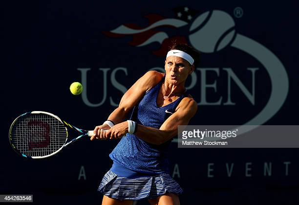 Lucie Safarova of the Czech Republic returns a shot against Saisai Zheng of China on Day Three of the 2014 US Open at the USTA Billie Jean King...