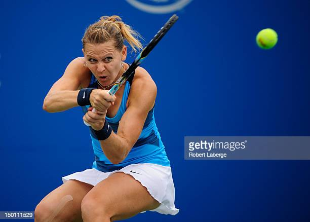 Lucie Safarova of the Czech Republic returns to Samantha Stosur of Australia during the third round at the Rogers Cup at the Uniprix Stadium on...